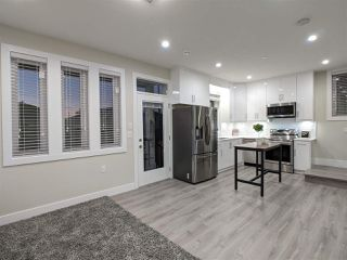 Photo 2: 4989 MOSS Street in Vancouver: Collingwood VE 1/2 Duplex for sale (Vancouver East)  : MLS®# R2525974