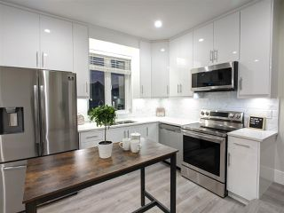 Photo 3: 4989 MOSS Street in Vancouver: Collingwood VE 1/2 Duplex for sale (Vancouver East)  : MLS®# R2525974