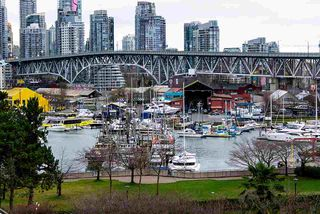 """Photo 1: 501 1470 PENNYFARTHING Drive in Vancouver: False Creek Condo for sale in """"HARBOUR COVE II"""" (Vancouver West)  : MLS®# R2451821"""