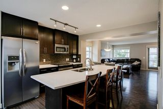 Photo 7: 35 ASPEN HILLS Green SW in Calgary: Aspen Woods Row/Townhouse for sale : MLS®# A1033284