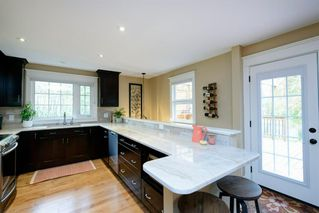 Photo 11: 35 Sydney Drive SW in Calgary: Southwood Detached for sale : MLS®# A1040691