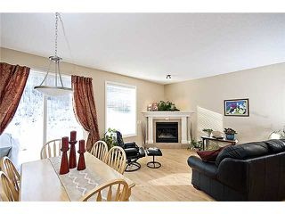 Photo 1: 164 CRAWFORD DRIVE: Cochrane Townhouse for sale : MLS®# C3454143