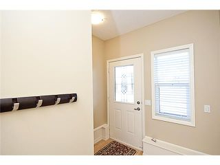 Photo 4: 164 CRAWFORD DRIVE: Cochrane Townhouse for sale : MLS®# C3454143