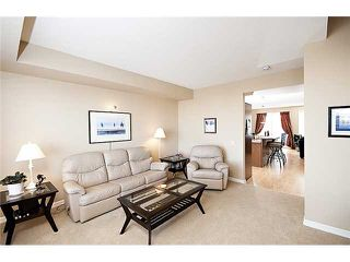 Photo 11: 164 CRAWFORD DRIVE: Cochrane Townhouse for sale : MLS®# C3454143