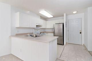 """Photo 6: 233 5880 DOVER Crescent in Richmond: Riverdale RI Condo for sale in """"WATERSIDE"""" : MLS®# R2501420"""