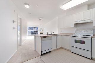 """Photo 3: 233 5880 DOVER Crescent in Richmond: Riverdale RI Condo for sale in """"WATERSIDE"""" : MLS®# R2501420"""