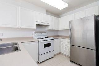 """Photo 5: 233 5880 DOVER Crescent in Richmond: Riverdale RI Condo for sale in """"WATERSIDE"""" : MLS®# R2501420"""