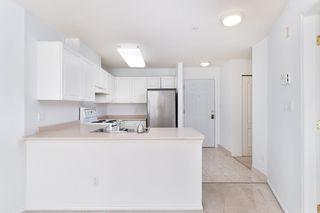"""Photo 7: 233 5880 DOVER Crescent in Richmond: Riverdale RI Condo for sale in """"WATERSIDE"""" : MLS®# R2501420"""
