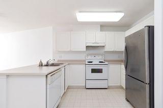 """Photo 4: 233 5880 DOVER Crescent in Richmond: Riverdale RI Condo for sale in """"WATERSIDE"""" : MLS®# R2501420"""