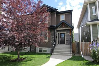Photo 1: 3110 4A Street NW in Calgary: Mount Pleasant Semi Detached for sale : MLS®# A1059835