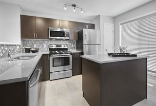 Photo 3: 105 3305 Orchards Link in Edmonton: Zone 53 Townhouse for sale : MLS®# E4175886