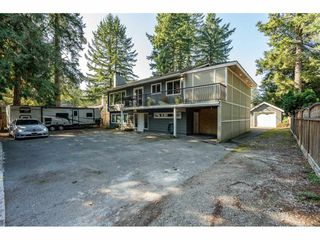 Photo 1: 4503 200 Street in Langley: Langley City House for sale : MLS®# R2506077
