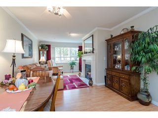 "Photo 5: 125 13880 70 Avenue in Surrey: East Newton Condo for sale in ""Chelsea Gardens"" : MLS®# R2419159"