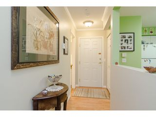 "Photo 10: 125 13880 70 Avenue in Surrey: East Newton Condo for sale in ""Chelsea Gardens"" : MLS®# R2419159"