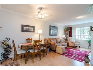 "Photo 4: 125 13880 70 Avenue in Surrey: East Newton Condo for sale in ""Chelsea Gardens"" : MLS®# R2419159"