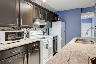 Photo 8: 256 Shawinigan Drive SW in Calgary: Shawnessy Row/Townhouse for sale : MLS®# A1050807
