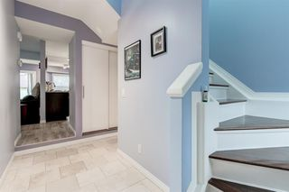 Photo 4: 256 Shawinigan Drive SW in Calgary: Shawnessy Row/Townhouse for sale : MLS®# A1050807