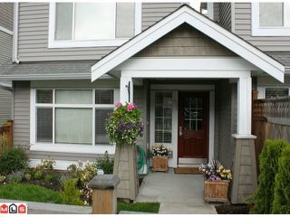 "Photo 1: 41 19330 69TH Avenue in Surrey: Clayton Townhouse for sale in ""Montebello"" (Cloverdale)  : MLS®# F1015770"