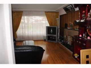 """Photo 2: 1351 E 49TH Avenue in Vancouver: Knight House for sale in """"SOUTH VANCOUVER"""" (Vancouver East)  : MLS®# V792798"""