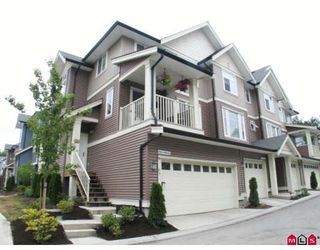 "Photo 1: 94 6575 192ND Street in Surrey: Clayton Townhouse for sale in ""Ixia"" (Cloverdale)  : MLS®# F2905243"