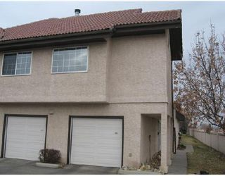Photo 1: 402 1997 SIROCCO Drive SW in CALGARY: Signature Parke Townhouse for sale (Calgary)  : MLS®# C3358974