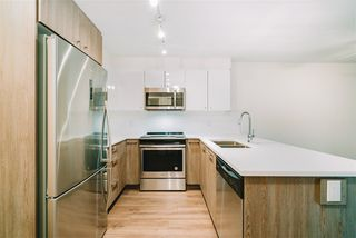 """Photo 7: 203 2525 CLARKE Street in Port Moody: Port Moody Centre Condo for sale in """"The Strand"""" : MLS®# R2461641"""