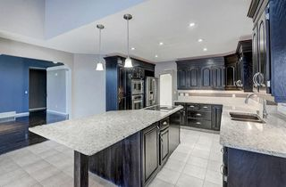 Photo 4: 864 SHAWNEE Drive SW in Calgary: Shawnee Slopes Detached for sale : MLS®# C4282551