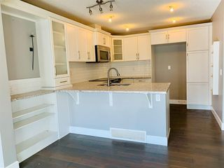 Photo 3: 408 Windstone Grove SW: Airdrie Row/Townhouse for sale : MLS®# A1040514