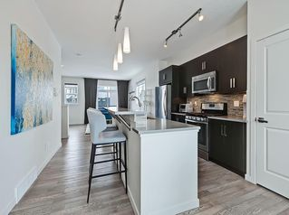 Photo 5: 624 WALDEN Circle SE in Calgary: Walden Row/Townhouse for sale : MLS®# C4288347