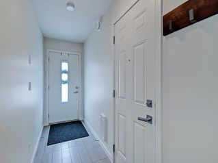Photo 3: 624 WALDEN Circle SE in Calgary: Walden Row/Townhouse for sale : MLS®# C4288347