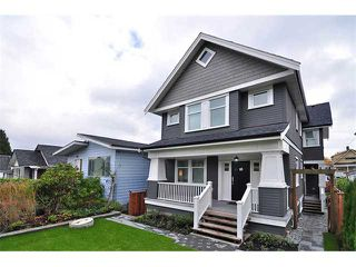 Photo 1: 1370 E 13TH Avenue in Vancouver: Grandview VE House 1/2 Duplex for sale (Vancouver East)  : MLS®# V856912