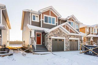 Photo 1: 559 Ebbers Way in Edmonton: Zone 02 House Half Duplex for sale : MLS®# E4180643