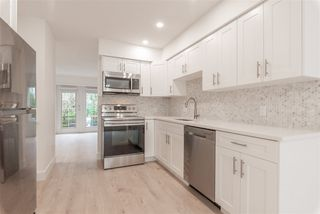 """Photo 1: 15 15488 101A Avenue in Surrey: Guildford Townhouse for sale in """"Cobblefield Lane"""" (North Surrey)  : MLS®# R2449529"""