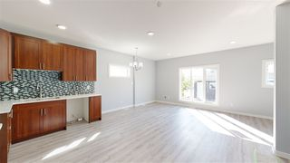 Photo 3: 11812 64 Street NW in Edmonton: Zone 06 Duplex Front and Back for sale : MLS®# E4222512