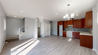 Photo 4: 11812 64 Street NW in Edmonton: Zone 06 Duplex Front and Back for sale : MLS®# E4222512
