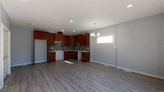 Photo 5: 11812 64 Street NW in Edmonton: Zone 06 Duplex Front and Back for sale : MLS®# E4222512