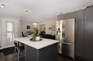 Photo 3: 150 SIERRA MORENA Green SW in Calgary: Signal Hill Semi Detached for sale : MLS®# C4294860