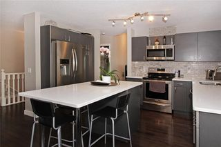 Photo 2: 150 SIERRA MORENA Green SW in Calgary: Signal Hill Semi Detached for sale : MLS®# C4294860
