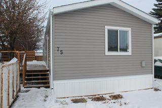 Photo 1: 75 9090 24 Street SE in Calgary: Riverbend Mobile for sale : MLS®# A1049275
