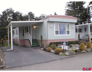 """Photo 1: 115 3665 244 Street in LANGLEY: Otter District Manufactured Home for sale in """"LANGLEY GROVE ESTATE"""" (Langley)  : MLS®# F2904207"""