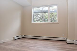 Photo 11: 105 69 SPRINGBOROUGH Court SW in Calgary: Springbank Hill Apartment for sale : MLS®# C4305544