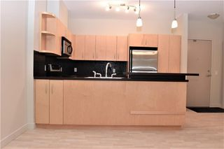 Photo 6: 105 69 SPRINGBOROUGH Court SW in Calgary: Springbank Hill Apartment for sale : MLS®# C4305544