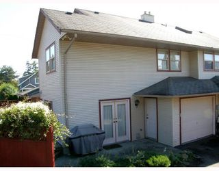Photo 2: 212 MARMONT Street in Coquitlam: Maillardville House 1/2 Duplex for sale : MLS®# V786525