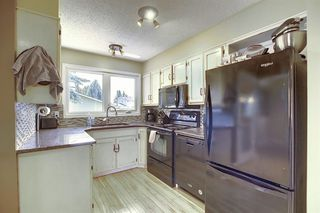 Photo 6: 408 QUEENSLAND Circle SE in Calgary: Queensland Detached for sale : MLS®# A1020270