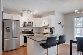 Photo 2: 3403 7171 Coach Hill Road SW in Calgary: Coach Hill Row/Townhouse for sale : MLS®# A1059752