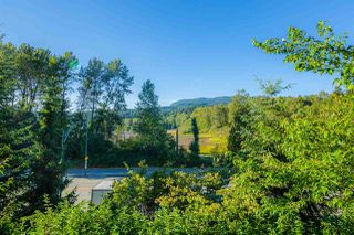 "Main Photo: 202 300 KLAHANIE Drive in Port Moody: Port Moody Centre Condo for sale in ""TIDES"" : MLS®# R2500345"