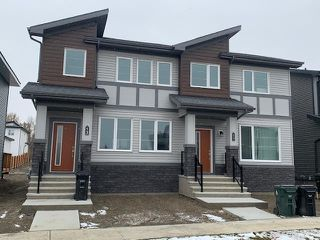 Photo 1: 667 LEWIS GREENS DRIVE in Edmonton: Zone 58 House Half Duplex for sale : MLS®# E4218517