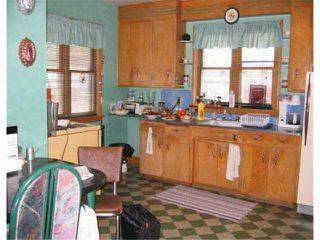 Photo 4: 491 MAGNUS Avenue in WINNIPEG: North End Residential for sale (North West Winnipeg)  : MLS®# 2407037