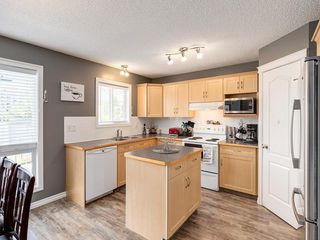Photo 8: 115 Cimarron Grove Crescent: Okotoks Detached for sale : MLS®# C4303234