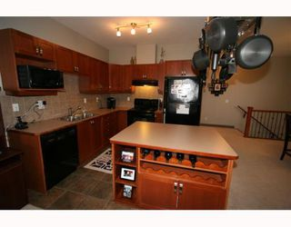 Photo 6: 502 8000 WENTWORTH Drive SW in CALGARY: West Springs Stacked Townhouse for sale (Calgary)  : MLS®# C3408202
